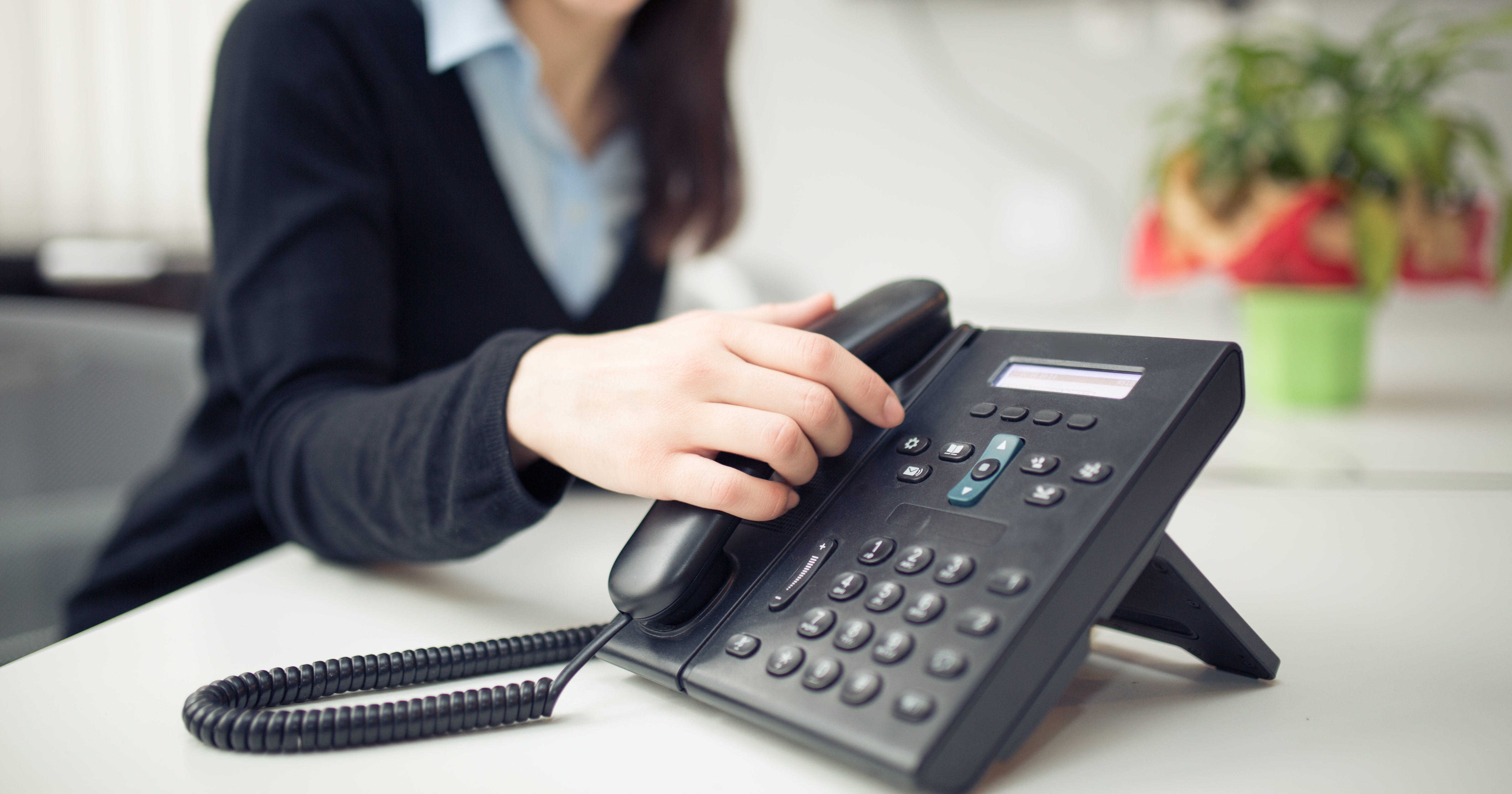Young business woman answering phone call.Good news